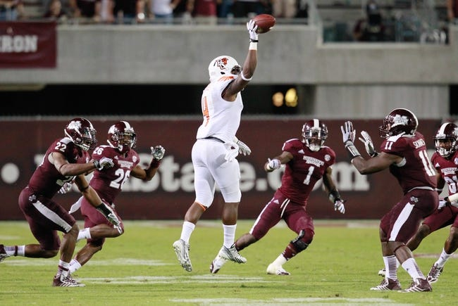 Oct 12, 2013; Starkville, MS, USA; Bowling Green Falcons running back Jordan Hopgood (4) pitches the ball back during the last play against the Mississippi State Bulldogs at Davis Wade Stadium. The Bulldogs defeated the Falcons 21-20. Mandatory Credit: Marvin Gentry-USA TODAY Sports