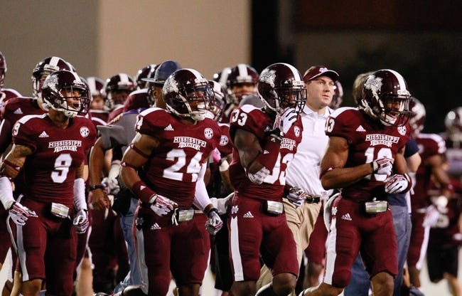 Oct 12, 2013; Starkville, MS, USA; Mississippi State Bulldogs come onto the field  prior to the game against the Bowling Green Falcons at Davis Wade Stadium. Mandatory Credit: Marvin Gentry-USA TODAY Sports