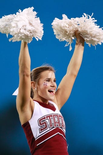 Oct 12, 2013; Starkville, MS, USA; Mississippi State Bulldogs cheerleader  prior to the game against the Bowling Green Falcons at Davis Wade Stadium. Mandatory Credit: Marvin Gentry-USA TODAY Sports
