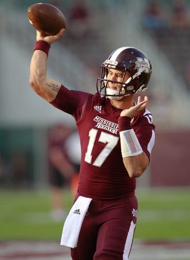 Oct 12, 2013; Starkville, MS, USA; Mississippi State Bulldogs quarterback Tyler Russell (17) throws a pass prior to the game against the Bowling Green Falcons at Davis Wade Stadium. Mandatory Credit: Marvin Gentry-USA TODAY Sports