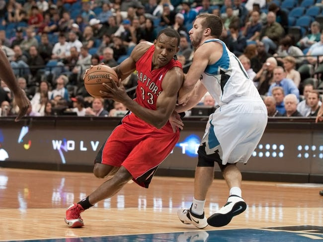 Oct 12, 2013; Minneapolis, MN, USA; Toronto Raptors small forward Chris Wright (33) dribbles while defended by Minnesota Timberwolves point guard J.J. Barea (11) in the second quarter at Target Center. Raptors won 104-97. Mandatory Credit: Greg Smith-USA TODAY Sports