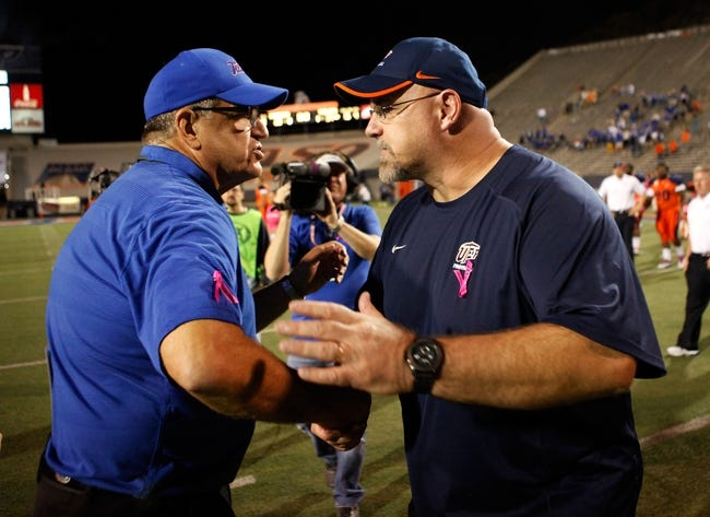 Oct 12, 2013; El Paso, TX, USA; Tulsa Hurricane head coach Bill Blankenship shakes hands with UTEP Miners head coach Sean Kugler after the game at Sun Bowl Stadium. Tulsa defeated UTEP 34-20. Mandatory Credit: Ivan Pierre Aguirre-USA TODAY Sports
