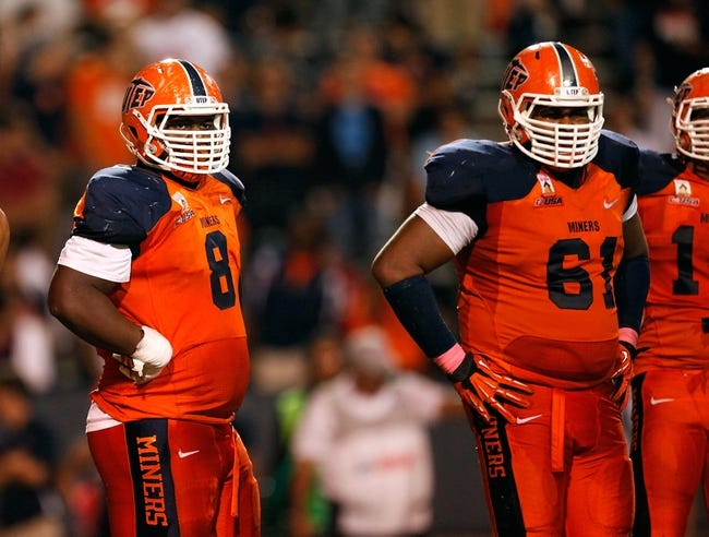 Oct 12, 2013; El Paso, TX, USA; UTEP Miners defensive lineman Marcus Bagley (8) looks at the sideline before a play against the Tulsa Hurricane offense at Sun Bowl Stadium. Tulsa defeated UTEP 34-20. Mandatory Credit: Ivan Pierre Aguirre-USA TODAY Sports