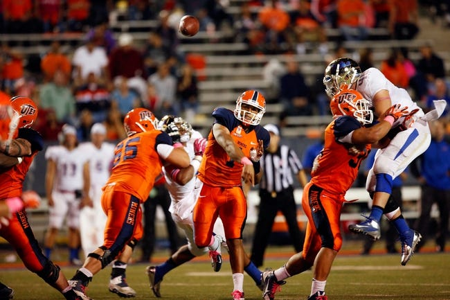 Oct 12, 2013; El Paso, TX, USA; UTEP Miners quarterback Jameill Showers (1) passes the ball against the Tulsa Hurricane defense at Sun Bowl Stadium. Tulsa defeated UTEP 34-20. Mandatory Credit: Ivan Pierre Aguirre-USA TODAY Sports
