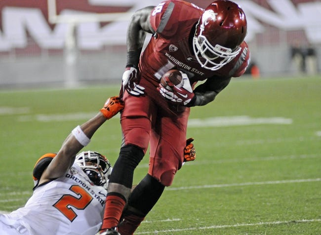 Oct 12, 2013; Pullman, WA, USA; Washington State Cougars wide receiver Kristoff Williams (18) is brought down by Oregon State Beavers cornerback Steven Nelson (2) during the first half at Martin Stadium. Mandatory Credit: James Snook-USA TODAY Sports
