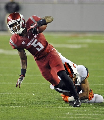 Oct 12, 2013; Pullman, WA, USA; Washington State Cougars wide receiver Rickey Galvin (5) is tackled by Oregon State Beavers cornerback Sean Martin (6) during the first half at Martin Stadium. Mandatory Credit: James Snook-USA TODAY Sports