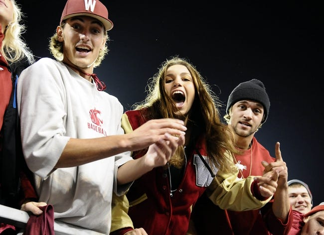 Oct 12, 2013; Pullman, WA, USA; A group of Washington State Cougar fans cheer against the Oregon State Beaver during the first half at Martin Stadium. Mandatory Credit: James Snook-USA TODAY Sports