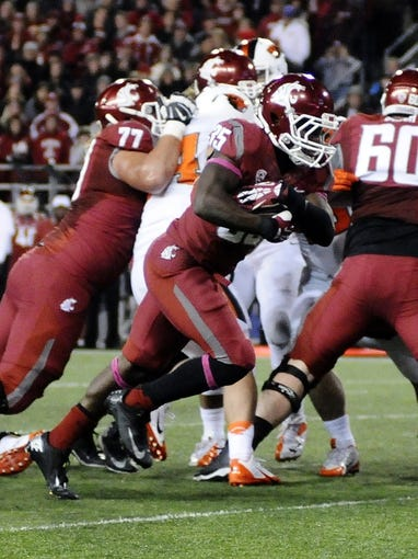 Oct 12, 2013; Pullman, WA, USA; Washington State Cougars running back Marcus Mason (35) scores a touchdown against the Oregon State Beavers during the first half at Martin Stadium. Mandatory Credit: James Snook-USA TODAY Sports