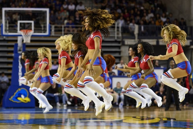 Oct 11, 2013; Newark, DE, USA; Philadelphia 76ers dream team dancers perform during the third quarter against the Boston Celtics at Bob Carpenter Sports Convocation Center. The Sixers defeated the Celtics 97-85. Mandatory Credit: Howard Smith-USA TODAY Sports