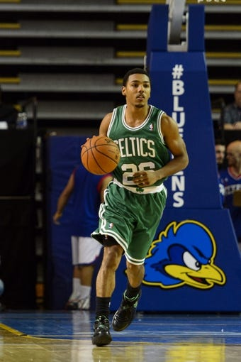 Oct 11, 2013; Newark, DE, USA; Boston Celtics guard Phil Pressey (26) brings the ball up court during the third quarter against the Philadelphia 76ers at Bob Carpenter Sports Convocation Center. The Sixers defeated the Celtics 97-85. Mandatory Credit: Howard Smith-USA TODAY Sports