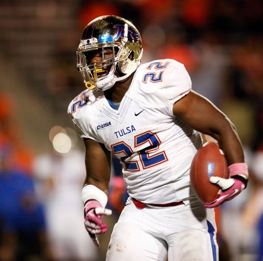 Oct 12, 2013; El Paso, TX, USA; Tulsa Hurricane running back Trey Watts (22) runs the ball against the UTEP Miners defense at Sun Bowl Stadium. Tulsa defeated UTEP 30-20. Mandatory Credit: Ivan Pierre Aguirre-USA TODAY Sports