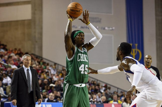 Oct 11, 2013; Newark, DE, USA; Boston Celtics forward Gerald Wallace (45) passes the ball under pressure from Philadelphia 76ers guard Tony Wroten (8) during the fourth quarter at Bob Carpenter Sports Convocation Center. The Sixers defeated the Celtics 97-85. Mandatory Credit: Howard Smith-USA TODAY Sports