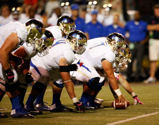 Oct 12, 2013; El Paso, TX, USA; Tulsa Hurricane offensive line get set before snapping the ball gainst the UTEP Miners defense at Sun Bowl Stadium. Tulsa defeated UTEP 30-20. Mandatory Credit: Ivan Pierre Aguirre-USA TODAY Sports