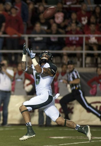 Oct 12, 2013; Las Vegas, NV, USA; Hawaii Rainbow Warriors wide receiver Billy Ray Stutzmann (10) reels in a long touchdown pass from quarterback Sean Schroeder during an NCAA football game against the UNLV Rebels at Sam Boyd Stadium. The Rebels won the game 39-37. Mandatory Credit: Stephen R. Sylvanie-USA TODAY Sports