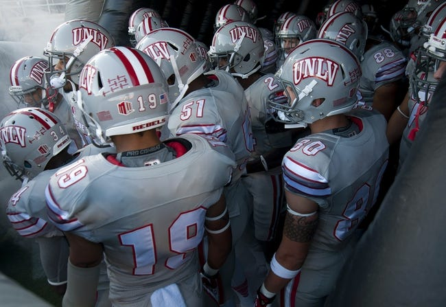 Oct 12, 2013; Las Vegas, NV, USA; The UNLV Rebels prepare to take the field before an NCAA football game against visiting Hawaii at Sam Boyd Stadium. The Rebels won the game 39-37. Mandatory Credit: Stephen R. Sylvanie-USA TODAY Sports