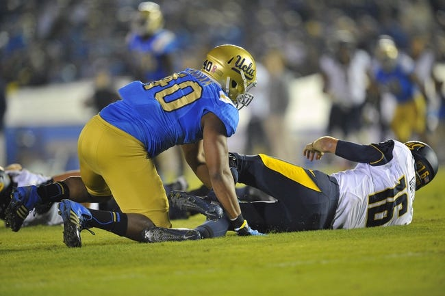 October 12, 2013; Pasadena, CA, USA; California Golden Bears quarterback Jared Goff (16) is brought down by UCLA Bruins defensive end Keenan Graham (40) during the second half at the Rose Bowl. Mandatory Credit: Gary A. Vasquez-USA TODAY Sports