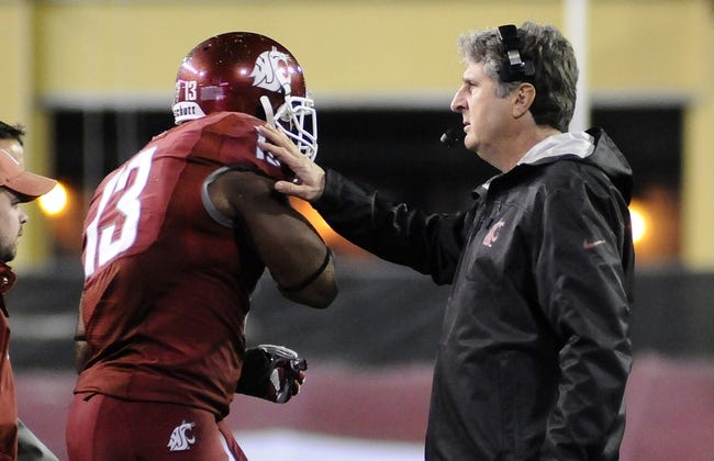 Oct 12, 2013; Pullman, WA, USA; Washington State Cougars head coach Mike Leach with linebacker Tana Pritchard (33) during the first half against the Oregon State Beavers at Martin Stadium. Mandatory Credit: James Snook-USA TODAY Sports
