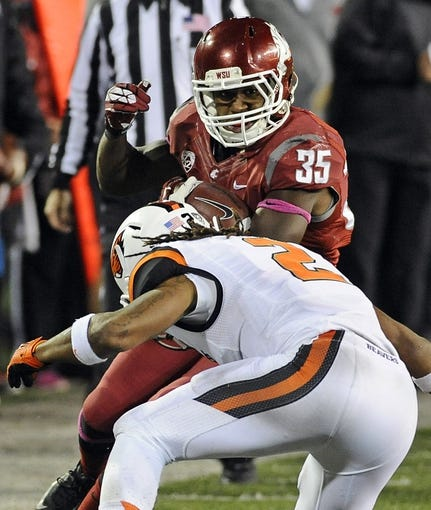 Oct 12, 2013; Pullman, WA, USA; Washington State Cougars running back Marcus Mason (35) is tackled by Oregon State Beavers cornerback Steven Nelson (2) during the first half at Martin Stadium. The Beavers beat the Cougars 52-24. Mandatory Credit: James Snook-USA TODAY Sports