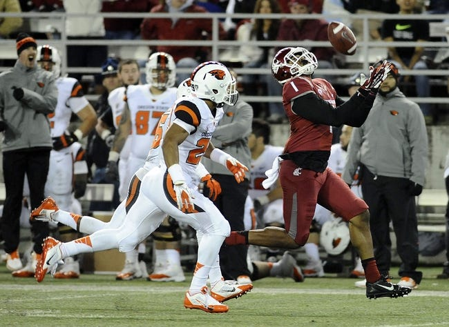Oct 12, 2013; Pullman, WA, USA; Washington State Cougars wide receiver Vince Mayle (1) makes a catch against Oregon State Beavers cornerback Malcolm Marable (22) during the second half at Martin Stadium. The Beavers beat the Cougars 52-24. Mandatory Credit: James Snook-USA TODAY Sports