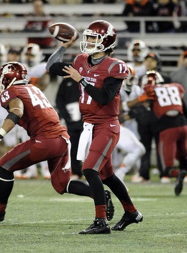 Oct 12, 2013; Pullman, WA, USA; Washington State Cougars quarterback Austin Apodaca (17) drops back for a pass against the Oregon State Beavers during the second half at Martin Stadium. The Beavers beat the Cougars 52-24. Mandatory Credit: James Snook-USA TODAY Sports