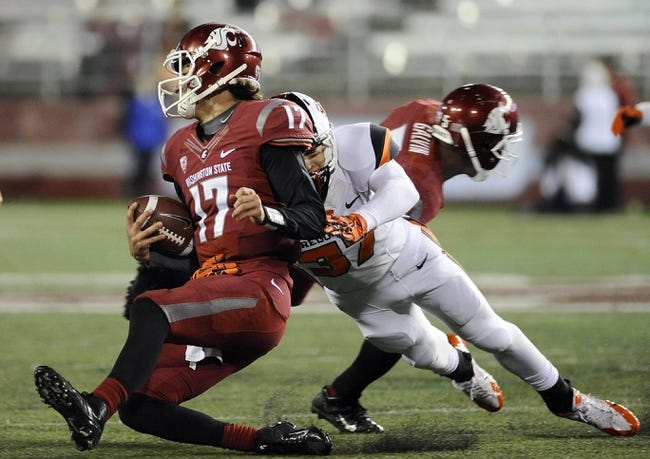 Oct 12, 2013; Pullman, WA, USA; Washington State Cougars quarterback Austin Apodaca (17) slides against Oregon State Beavers safety Micah Audiss (37) during the second half at Martin Stadium. The Beavers beat the Cougars 52-24. Mandatory Credit: James Snook-USA TODAY Sports