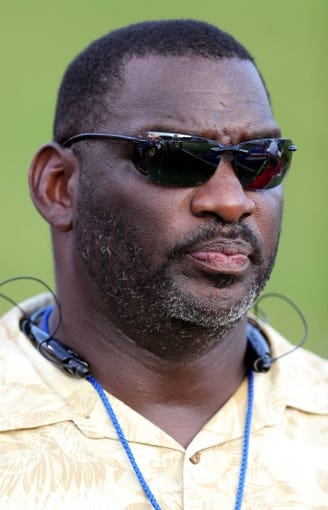 Sep 12, 2013; Ruston, LA, USA; Former NFL quarterback Doug Williams on the sidelines before the Louisiana Tech Bulldogs game against the Tulane Green Wave at Joe Aillet Stadium. Mandatory Credit: Chuck Cook-USA TODAY Sports