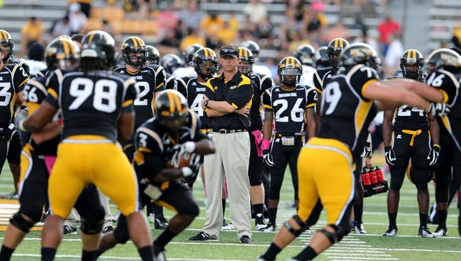 Oct 5, 2013; Hattiesburg, MS, USA; Southern Miss Golden Eagles head coach Todd Monken watches his team get ready to play against the FIU Golden Panthers at M.M. Roberts Stadium. Mandatory Credit: Chuck Cook-USA TODAY Sports