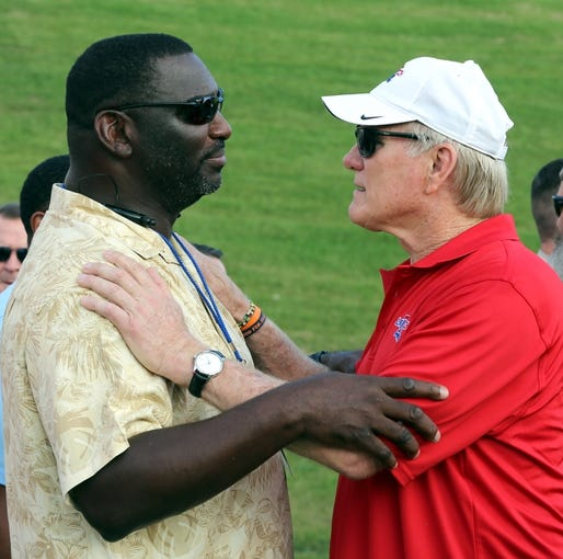 Sep 12, 2013; Ruston, LA, USA; Former NFL quarterbacks Doug Williams and Terry Bradshow talk to one another before the the Louisiana Tech Bulldogs game against the Tulane Green Wave at Joe Aillet Stadium. Williams was dismissed as the head coach at Grambling State University yesterday. Mandatory Credit: Chuck Cook-USA TODAY Sports