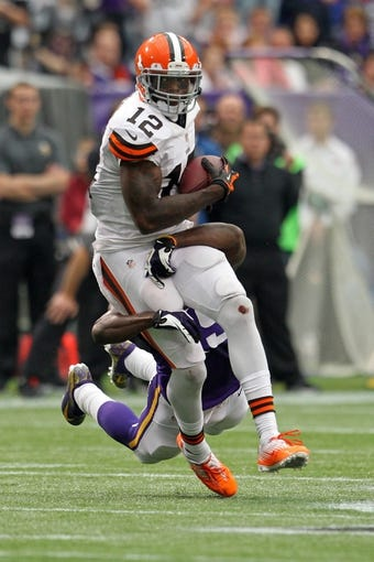 Sep 22, 2013; Minneapolis, MN, USA; Cleveland Browns wide receiver Josh Gordon (12) against the Minnesota Vikings at Mall of America Field at H.H.H. Metrodome. The Browns defeated the Vikings 31-27. Mandatory Credit: Brace Hemmelgarn-USA TODAY Sports