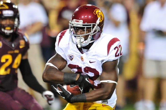 Sep 28, 2013; Tempe, AZ, USA; USC Trojans running back Justin Davis (22) during the game against the Arizona State Sun Devils at Sun Devil Stadium. Mandatory Credit: Matt Kartozian-USA TODAY Sports
