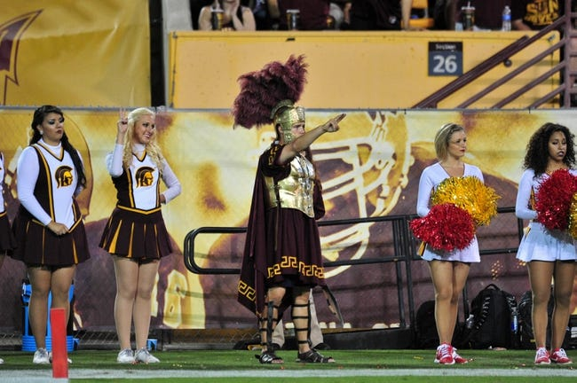 Sep 28, 2013; Tempe, AZ, USA; USC Trojans cheerleaders and trojan mascot during the game against the Arizona State Sun Devils at Sun Devil Stadium. Mandatory Credit: Matt Kartozian-USA TODAY Sports