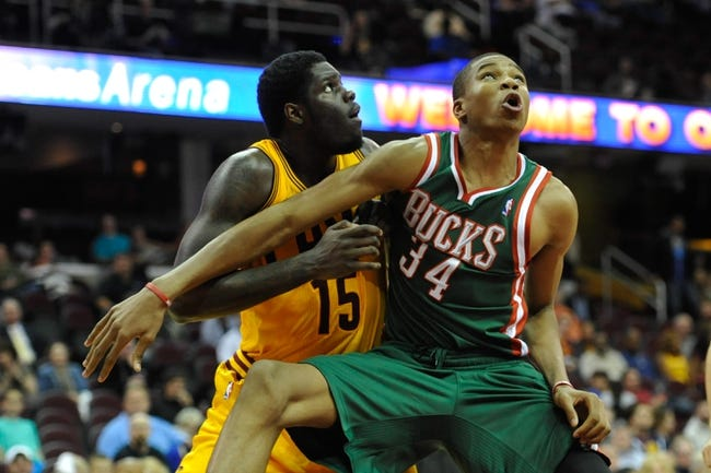 Oct 8, 2013; Cleveland Cavaliers power forward Anthony Bennett (15) and Milwaukee Bucks shooting guard Giannis Antetokounmpo (34) during a game at Quicken Loans Arena. Cleveland won 99-87. Mandatory Credit: David Richard-USA TODAY Sports