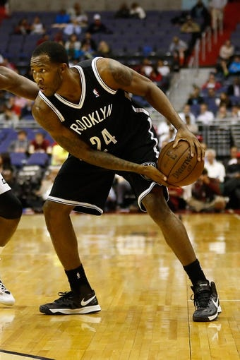 Oct 8, 2013; Washington, DC, USA; Brooklyn Nets forward Chris Johnson (24) holds the ball against the Washington Wizards at Verizon Center. Mandatory Credit: Geoff Burke-USA TODAY Sports
