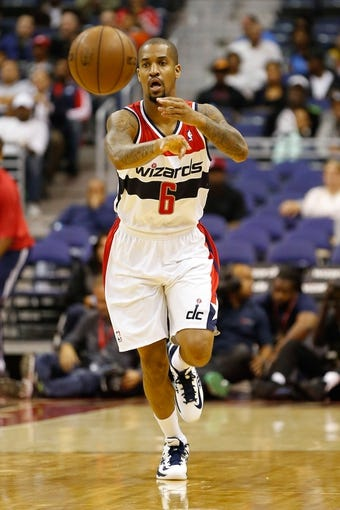 Oct 8, 2013; Washington, DC, USA; Washington Wizards point guard Eric Maynor (6) passes the ball against the Brooklyn Nets at Verizon Center. Mandatory Credit: Geoff Burke-USA TODAY Sports