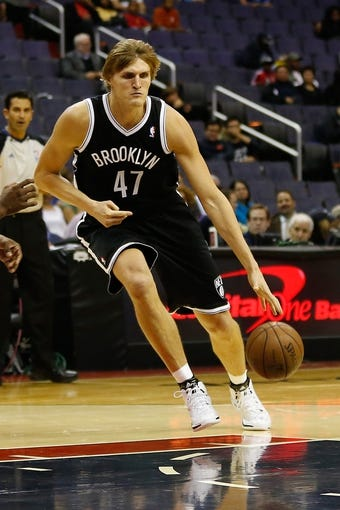 Oct 8, 2013; Washington, DC, USA; Brooklyn Nets small forward Andrei Kirilenko (47) dribbles the ball against the Washington Wizards at Verizon Center. Mandatory Credit: Geoff Burke-USA TODAY Sports