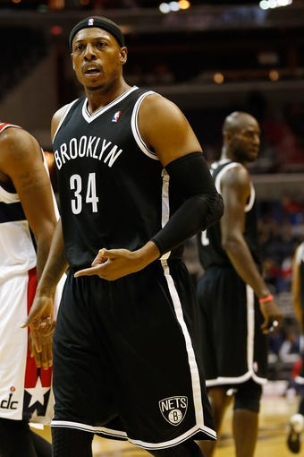 Oct 8, 2013; Washington, DC, USA; Brooklyn Nets small forward Paul Pierce (34) stands on the court against the Washington Wizards at Verizon Center. Mandatory Credit: Geoff Burke-USA TODAY Sports