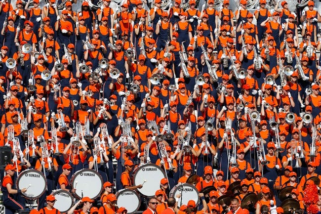Oct 5, 2013; Charlottesville, VA, USA; The Virginia Cavaliers marching band performs in the stands against the Ball State Cardinals at Scott Stadium. Mandatory Credit: Geoff Burke-USA TODAY Sports