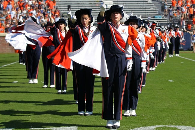 Oct 5, 2013; Charlottesville, VA, USA; Virginia Cavaliers  marching band members perform on the field prior to the Cavaliers game against the Ball State Cardinals at Scott Stadium. Mandatory Credit: Geoff Burke-USA TODAY Sports