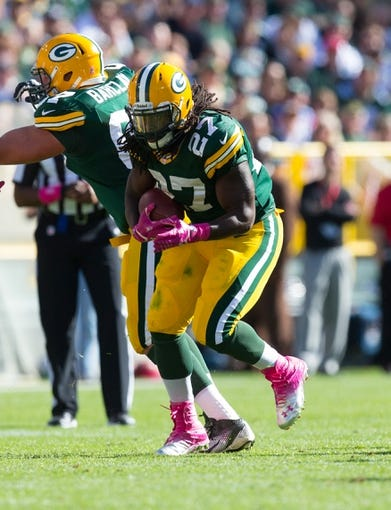 Oct 6, 2013; Green Bay, WI, USA; Green Bay Packers running back Eddie Lacy (27) during the game against the Detroit Lions at Lambeau Field.  Green Bay won 22-9.  Mandatory Credit: Jeff Hanisch-USA TODAY Sports
