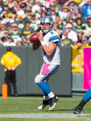 Oct 6, 2013; Green Bay, WI, USA; Detroit Lions quarterback Matthew Stafford (9) during the game against the Green Bay Packers at Lambeau Field.  Green Bay won 22-9.  Mandatory Credit: Jeff Hanisch-USA TODAY Sports