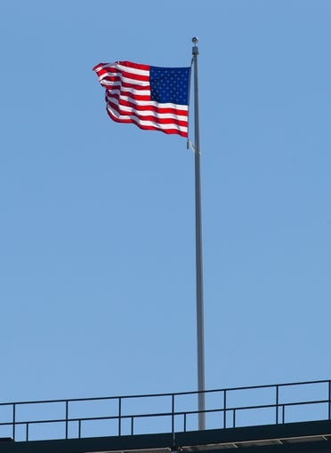 Oct 6, 2013; Green Bay, WI, USA; The American flag flies over Lambeau Field during the game between the Detroit Lions and Green Bay Packers.  Green Bay won 22-9.  Mandatory Credit: Jeff Hanisch-USA TODAY Sports