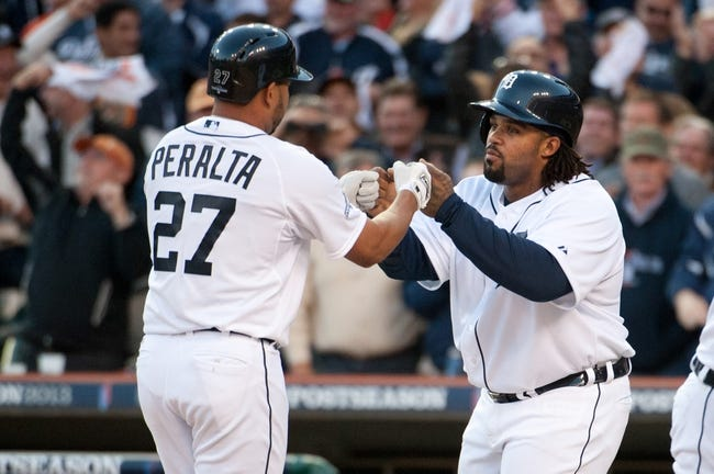 Oct 8, 2013; Detroit, MI, USA; Detroit Tigers shortstop Jhonny Peralta (27) celebrates his three run home run with first baseman Prince Fielder (28) in game four of the American League divisional series against the Oakland Athletics at Comerica Park. Mandatory Credit: Tim Fuller-USA TODAY Sports