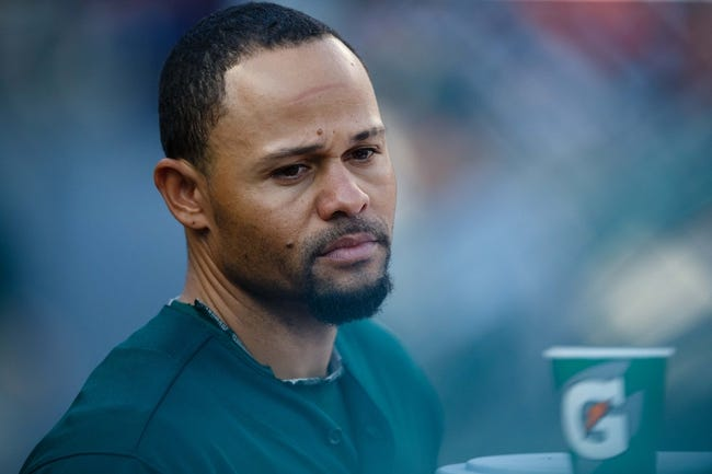 Oct 8, 2013; Detroit, MI, USA; Oakland Athletics center fielder Coco Crisp (4) in the dugout before game four of the American League divisional series against the Detroit Tigers at Comerica Park. Mandatory Credit: Rick Osentoski-USA TODAY Sports