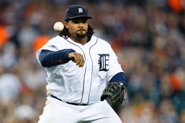 Oct 8, 2013; Detroit, MI, USA; Detroit Tigers first baseman Prince Fielder (28) makes a throw against the Oakland Athletics in game four of the American League divisional series at Comerica Park. Mandatory Credit: Rick Osentoski-USA TODAY Sports
