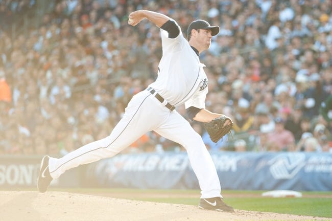 Oct 8, 2013; Detroit, MI, USA; Detroit Tigers starting pitcher Doug Fister (58) throws a pitch against the Oakland Athletics in game four of the American League divisional series at Comerica Park. Mandatory Credit: Tim Fuller-USA TODAY Sports
