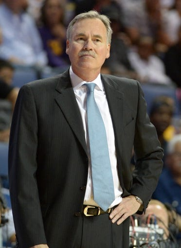 Oct 8, 2013; Ontario, CA, USA; Los Angeles Lakers coach Mike D'Antoni reacts during the game against the Denver Nuggets at Citizens Business Bank Arena. The Lakers defeated the Nuggets 90-88. Mandatory Credit: Kirby Lee-USA TODAY Sports