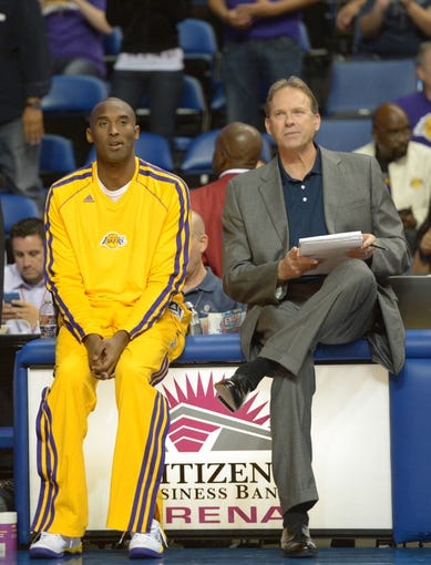 Oct 8, 2013; Ontario, CA, USA; Los Angeles Lakers guard Kobe Bryant (left) and assistant coach Kurt Rambis during the game against the Denver Nuggets at Citizens Business Bank Arena. The Lakers defeated the Nuggets 90-88. Mandatory Credit: Kirby Lee-USA TODAY Sports