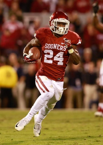 Oct 5, 2013; Norman, OK, USA; Oklahoma Sooners running back Brennan Clay (24) runs for a touchdown in the fourth quarter of the game against the TCU Horned Frogs at Gaylord Family - Oklahoma Memorial Stadium. The Oklahoma Sooners beat the TCU Horned Frogs 20-17. Mandatory Credit: Tim Heitman-USA TODAY Sports