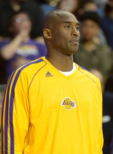 Oct 8, 2013; Ontario, CA, USA; Los Angeles Lakers guard Kobe Bryant reacts during the game against the Denver Nuggets at Citizens Business Bank Arena. The Lakers defeated the Nuggets 90-88. Mandatory Credit: Kirby Lee-USA TODAY Sports