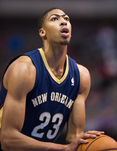 Oct 7, 2013; Dallas, TX, USA; New Orleans Pelicans power forward Anthony Davis (23) shoots a free throw during the game against the Dallas Mavericks at the American Airlines Center. The Pelicans defeated the Mavericks 94-92. Mandatory Credit: Jerome Miron-USA TODAY Sports
